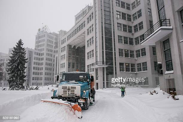 Employees utilities clearing Freedom Square in front of the Gosprom, in Kharkov, Ukraine, on December 30, 2014.