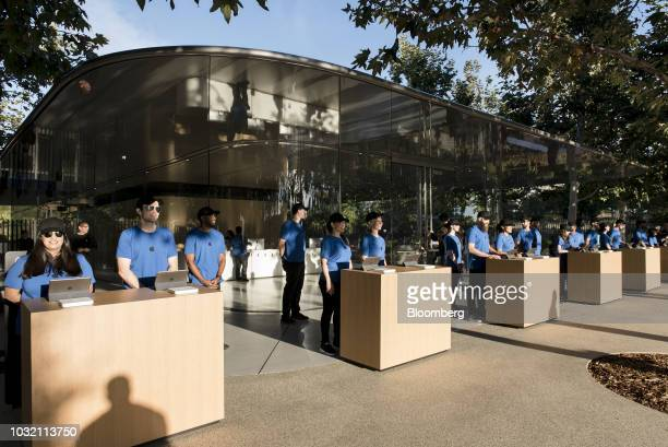 Employees wait for attendees ahead of an Apple Inc event at the Steve Jobs Theater in Cupertino California US on Wednesday Sept 12 2018 Apple will...