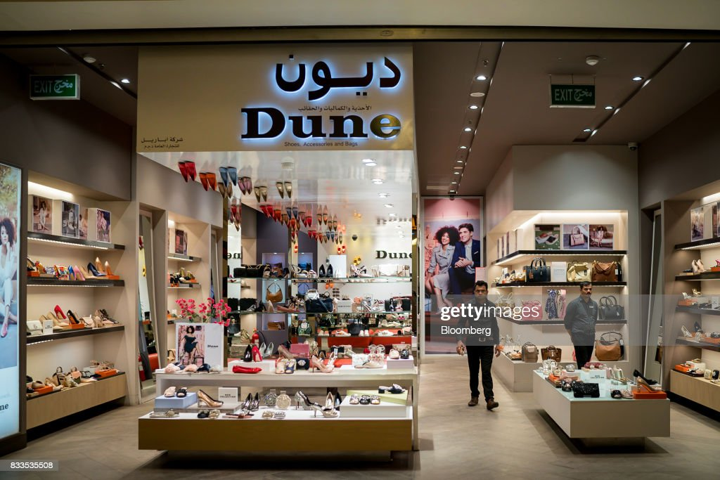 Employees wait for customers at the Dune shoe store in the Souq Sharq shopping mall Monday, Aug. 14, 2017. Kuwait will issue a tender to build the estimated $1.2 billion Dibdibah solar-power plant in the first quarter of 2018 as part of the countrys plans to produce 15 percent of power from renewable energy by 2030. Photographer: Tasneem Alsultan/Bloomberg via Getty Images