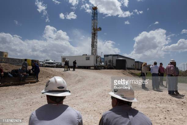 Employees wait for the arrival of US Vice President Mike Pence not pictured at a Diamondback Energy Inc oil rig in Midland Texas US on Wednesday...