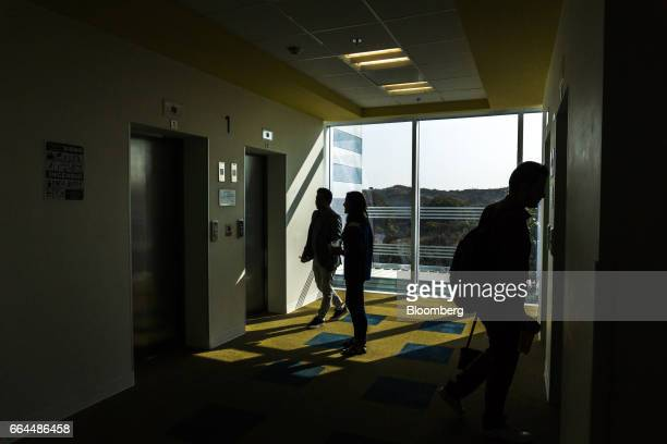 Employees wait for the elevator inside the Intel Corp design center in Guadalajara Mexico on Thursday March 9 2017 Guadalajara's Governor Aristoteles...