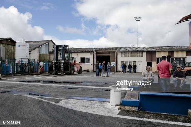 Employees wait to hear about the future of their jobs outside the GMS automobile parts factory in La Souterraine La Creuse region France on Monday...