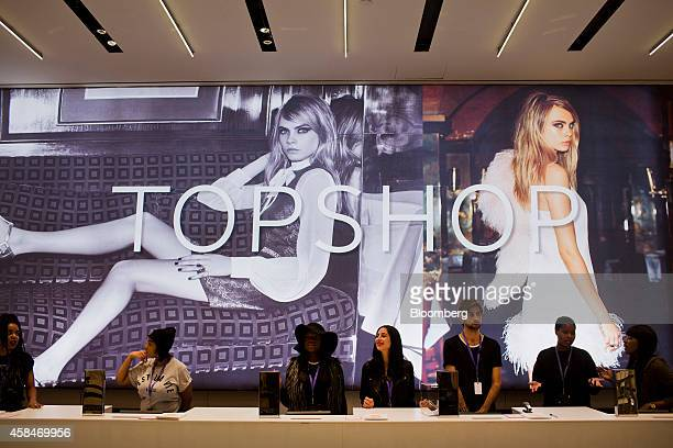 Employees wait to ring up shoppers during the grand opening of the Topshop Topman flagship store in New York US on Wednesday Nov 5 2014 Beyonce has...