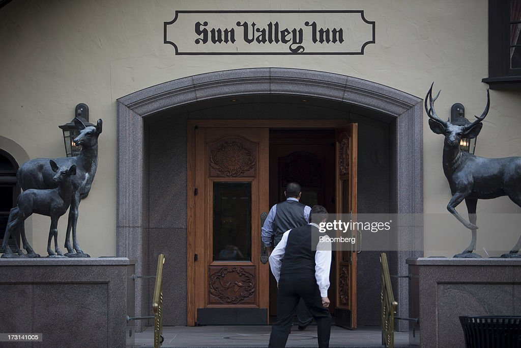 Employees walk into the Sun Valley Inn ahead of the Allen & Co. Media and Technology Conference in Sun Valley, Idaho, U.S., on Monday, July 8, 2013. Billionaires, chief executive officers and leaders from the technology, media, and finance industries will gather this week at the Idaho mountain resort conference hosted by investment banking firm Allen & Co. Photographer: Scott Eells/Bloomberg via Getty Images