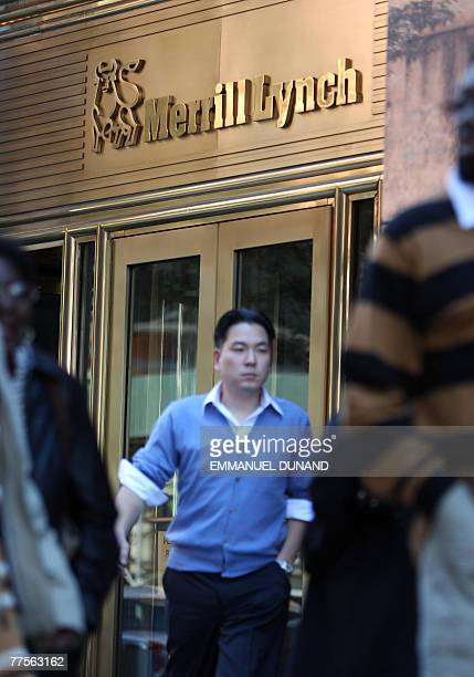 Employees walk past a sign at Merril Lynch headquarters in New York 30 October 2007 Merrill Lynch ousted chairman and chief executive Stan O'Neal...