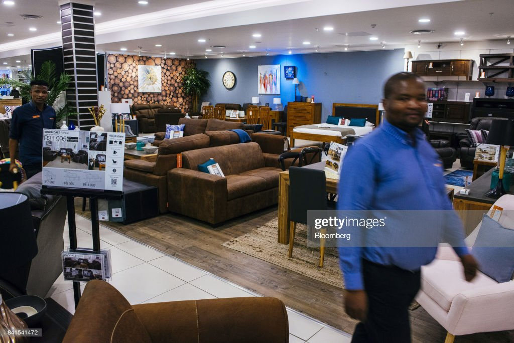 Employees walk past furniture displays inside a Rochester store, operated by Steinhoff International Holdings NV, in Johannesburg, South Africa, on Thursday, Aug. 31, 2017. Steinhoff said like-for-like sales rose 8 percent as the South African furniture and clothing retailer achieved gains in its core European and African markets. Photographer: Waldo Swiegers/Bloomberg via Getty Images