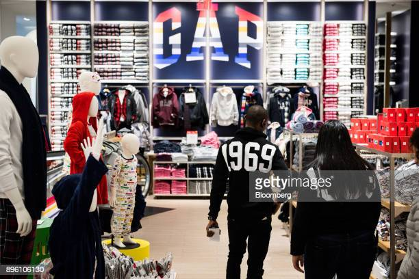 2c7dccff362 Employees walk past mannequins displayed at a Gap Inc store in New York US  on Wednesday