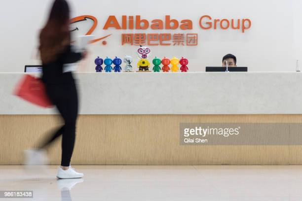 Employees walk through a building lobby at the Alibaba Group Holding Ltd headquarters in Hangzhou China on Tuesday Oct 13 2015