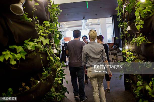 Employees walk through a hallway at Etsy Inc headquarters in the Brooklyn borough of New York US on Monday May 4 2015 Etsy Inc a marketplace for...