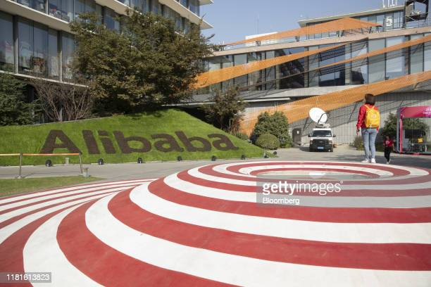 Employees walk through the campus at the Alibaba Group Holding Ltd headquarters during the annual November 11 Singles' Day online shopping event in...