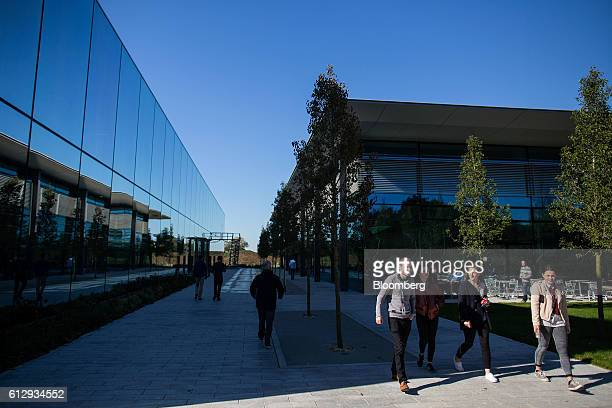 Employees walk through the grounds of the Dyson Ltd campus in Malmesbury UK on Wednesday Oct 5 2016 In addition to cordless cleaning products the...