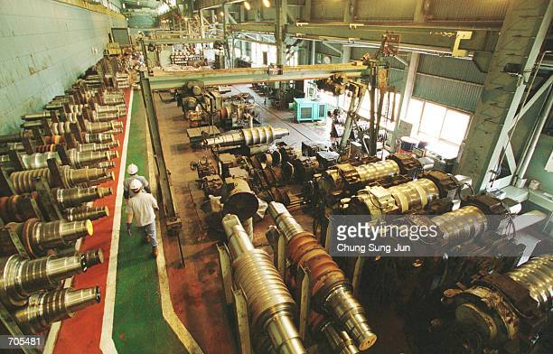 Employees walk through the Pohang Iron and Steel plant August 1 2002 in Pohang South Korea The company the worlds largest steel producer said March 6...