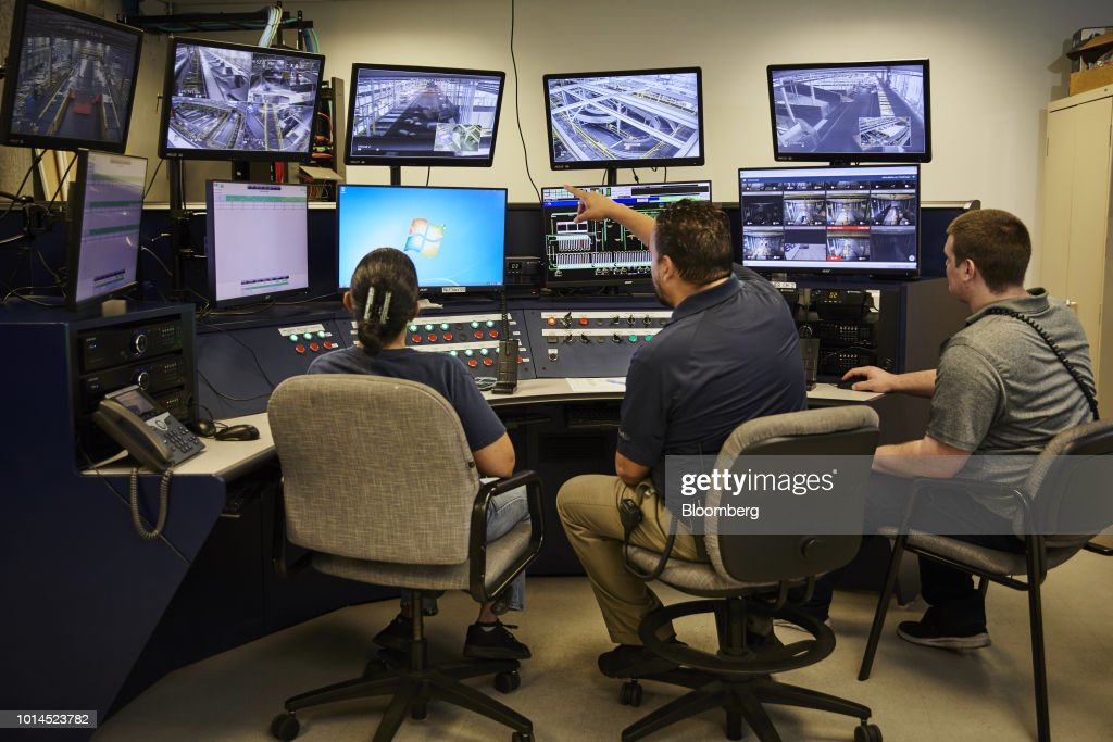 Employees watch video monitors in a control center at the FedEx Corp. Ground distribution center in Jersey City, New Jersey, U.S., on Tuesday, Aug. 7, 2018. FedEx is heading into fiscal 2019 running on all cylinders, with revenue growth and margin expansion expected across all three of its segments. Photographer: Marc McAndrews/Bloomberg via Getty Images