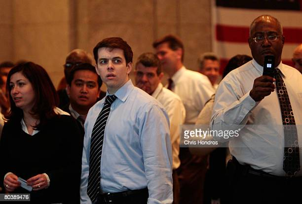 Employees watch with interest as protestors march in the lobby of Bear Stearns headquarters March 26, 2008 in New York. Hundreds of housing activists...