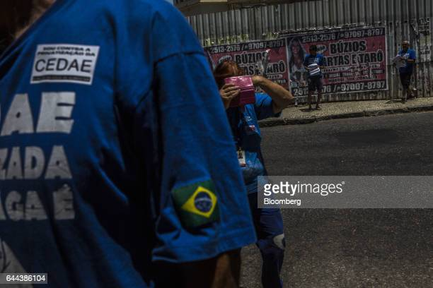 Employees wear shirts with slogans during a protest against the privatization of the State's water and sewage utility outside Cia Esadual de Aguas e...