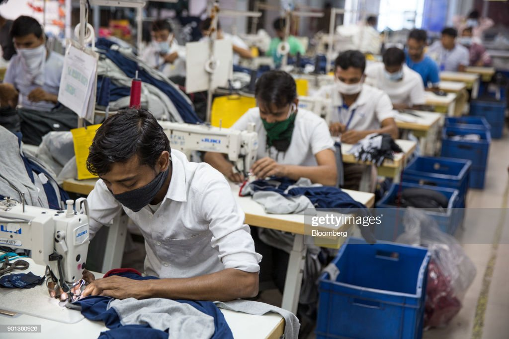 Face Wearing Machines Employees Mask A Operate Sewing At