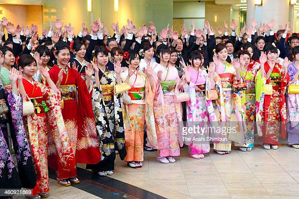 Employees wearing kimono make banzai cheers during a opening ceremony of the first trading day of the year at Osaka Securities Exchange on January 6...