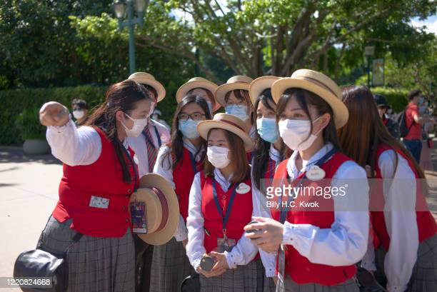 Employees wearing protective masks work at Walt Disney Co's Disneyland Resort on June 18 2020 in Hong Kong China
