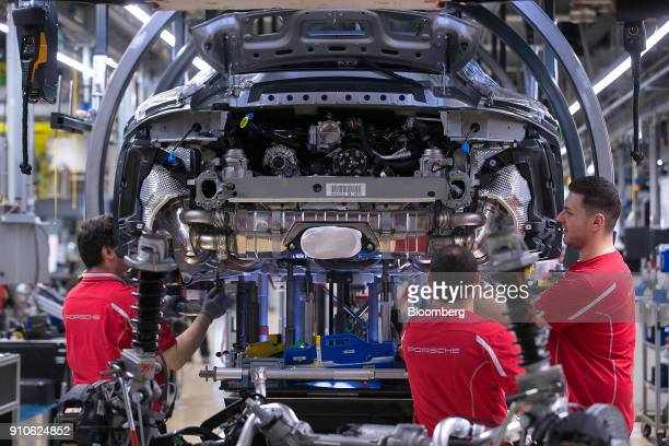 Employees wed the body and chassis of a Porsche 911 luxury automobile on the production line inside the Porsche AG factory in Stuttgart Germany on...