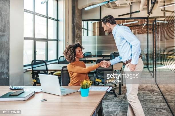 employees with female african american leader working together - candidate stock pictures, royalty-free photos & images