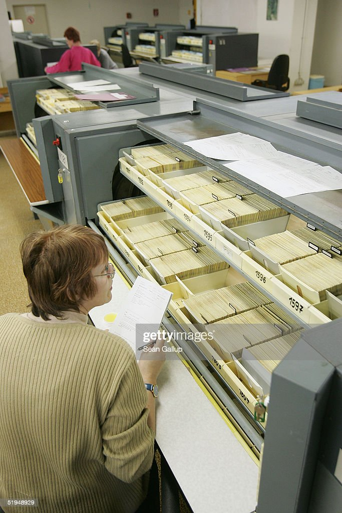 Employees work among the 5.1 milion data cards, each card representing one person, in the massive archives of the former Stasi, the secret police of the former East Germany January 13, 2005 in Berlin, Germany. Saturday, January 15, will mark the 15th anniversary of the storming of Stasi headquarters in Berlin by citizens in 1990, when the communist East German regime fell. The Stasi kept detailed records on millions of East Germans in a staggering volume of documents, most of which survive in today's archive. Over 90,000 people still apply evey year to see the files the Stasi kept on them.