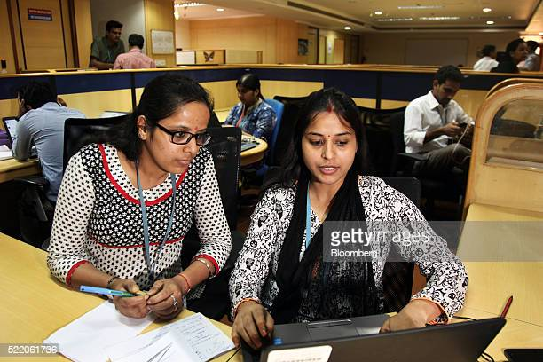 Employees work at a laptop computer at the Wipro Ltd headquarters in Bangalore India on Thursday April 14 2016 Wipro scheduled to release...