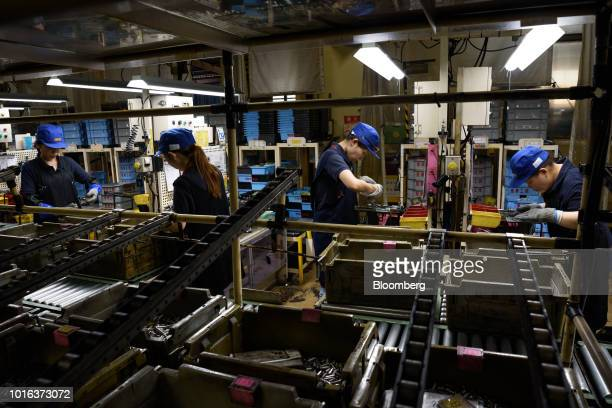 Employees work at an Asahi Tekko Co factory in Hekinan Aichi Prefecture Japan on Wednesday Aug 1 2018 Japan's government announced last month that it...