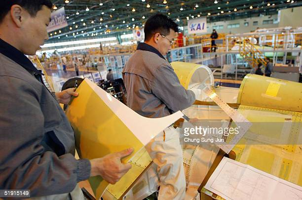Employees work at an assembly plant for the T50 Golden Eagle South Korea's first supersonic aircraft at Sachun air force base on January 5 in Sachun...