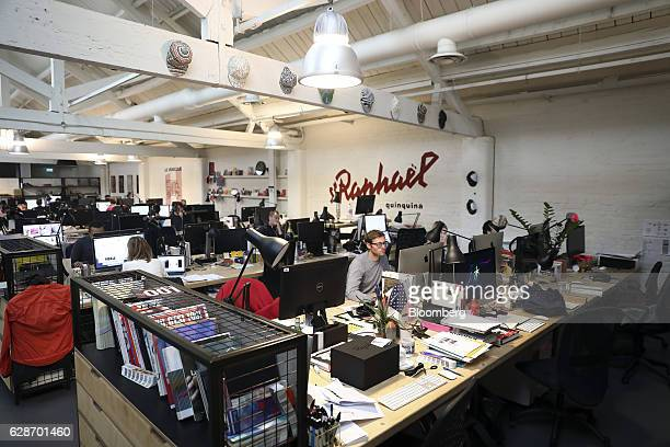 Employees work at computers at the Rapha Racing Ltd headquarters office in London UK on Thursday Nov 10 2016 To keep ahead of the competition Rapha...