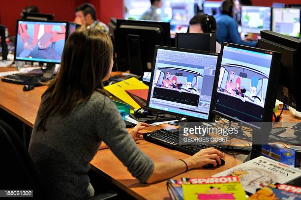 Employees work at Dupuis publishing house's Audiovisual Department on November 7 2013 in Marcinelle district in Charleroi '3D' is the next challenge...