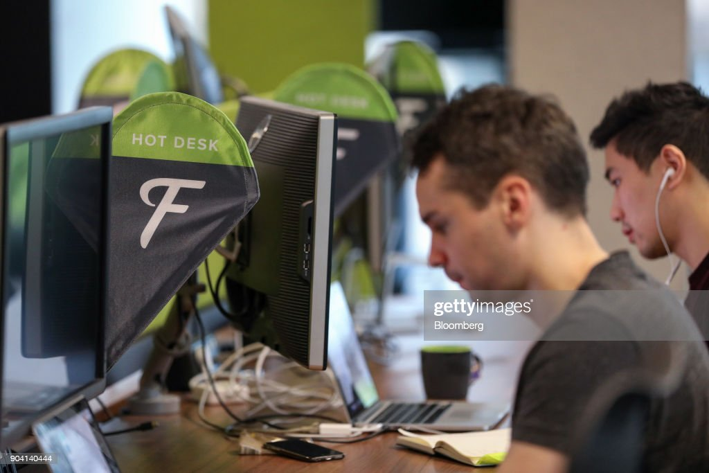 Employees work at hot desks at Fanduel Inc.'s offices in Edinburgh, U.K., on Tuesday, Feb. 7, 2017. More coders are choosing to live in Edinburgh over London, according to a report by developer community Stack Overflow, reported the Scotsman in Dec. 2017. Photographer: Chris Ratcliffe/Bloomberg via Getty Images