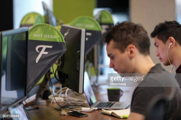 Employees work at hot desks at Fanduel Inc's offices in Edinburgh UK on Tuesday Feb 7 2017 More coders are choosing to live in Edinburgh over London...