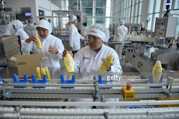 Employees work at L'Oreal's new factory in Cikarang, West Java, on