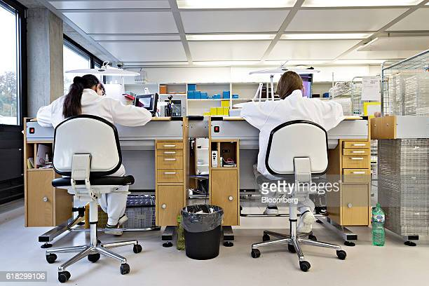 Employees work at technical desks in the assembly room at the Mondaine Watch Ltd production facility in Solothurn Switzerland on Tuesday Oct 25 2016...