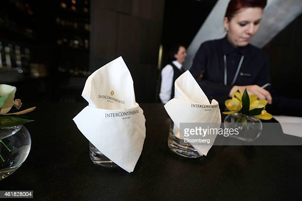 Employees work at the bar in the lobby of the InterContinental Hotel Davos operated by InterContinental Hotels Group Plc ahead of the World Economic...