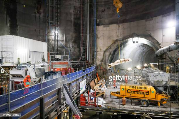 Employees work at the base of the main construction shaft at the Thames Tideway Tunnel super sewer construction project in London, U.K., on...
