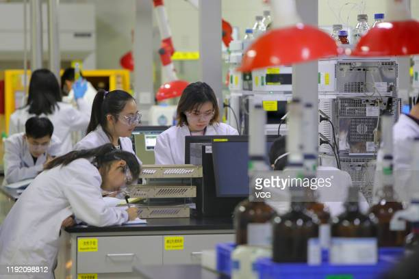 Employees work at the center for early phase pharmaceutical development of Asymchem Laboratories Inc a medical company on December 4 2019 in Tianjin...