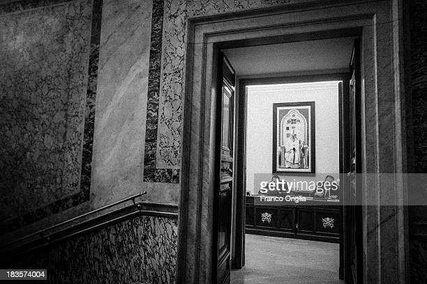 Employees work at the desk of the Vatican Prefecture in the Apostolic Palace on October 7 2013 in Vatican City Vatican After the success of his...