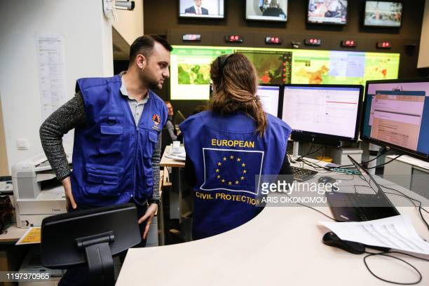 Employees work at the Emergency Response Coordination Centre in Brussels on January 29 following the outbreak of the coronavirus epidemic which has...
