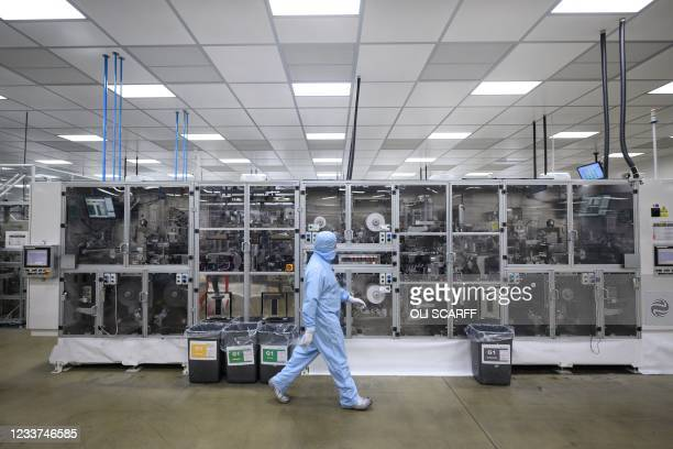 Employees work at the Envision battery manufacturing plant for the Nissan Leaf car at Nissan's plant in Sunderland, north east England on July 1,...