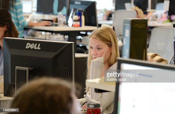 Employees work at the Facebook main campus in Menlo Park California May 15 2012 Facebook the world's most popular internet social network expects to...