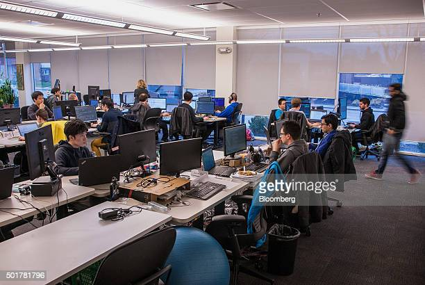 Employees work at the Maluuba Inc office in Waterloo Ontario Canada on Wednesday Dec 16 2015 Several leading Canadian researchers and professors have...