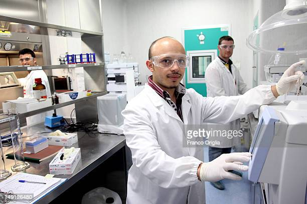 Employees work at the NSA radiopharmaceutical plant on July 08 2011 in Aedea Rome Italy Nuclear Specialists Associated Radiopharmacy preclinical...