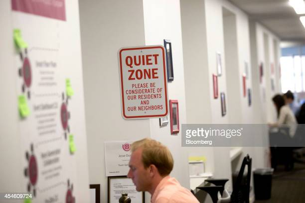 Employees work at the Social Tables Inc headquarters in Washington DC US on Thursday Aug 14 2014 Success stories like Social Tables' are going to get...