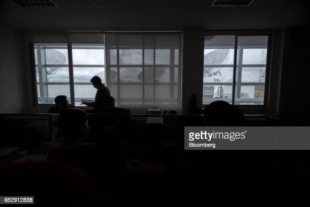 Employees work at the telecommunications port at the Bolivian Space Agency Amachuma Ground Station in Achocalla La Paz Department Bolivia on...