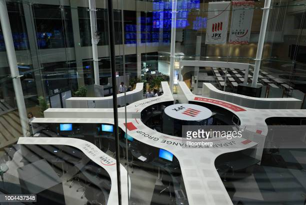 Employees work at the Tokyo Stock Exchange operated by Japan Exchange Group Inc in Tokyo Japan on Tuesday July 24 2018 Japanese shares rose with...