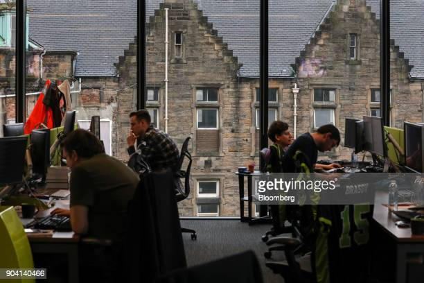 Employee's work at their desks against a backdrop of stone buildings at Fanduel Inc's offices in Edinburgh UK on Tuesday Feb 7 2017 More coders are...