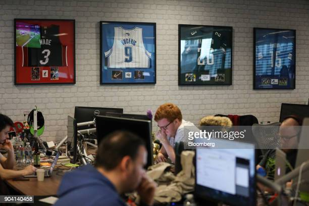 Employee's work at their desks at Fanduel Inc's offices in Edinburgh UK on Tuesday Feb 7 2017 More coders are choosing to live in Edinburgh over...