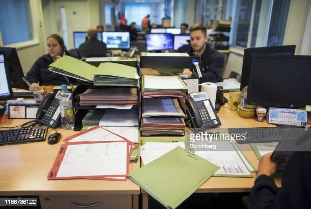 Employees work at their desks at the offices of George Baker Shipping Ltd. In Felixstowe, U.K., on Thursday, Nov. 21, 2019. Across British industry,...