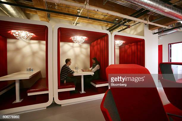 Employees work in a booth at one of the common areas at Google Canada's engineering headquarters in Waterloo Ontario Canada on Friday Jan 22 2016 The...